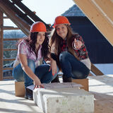 Two young women workers on the roof Stock Images
