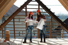 Two young women workers on the roof Royalty Free Stock Photography