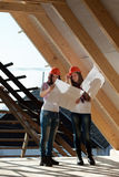 Two young women workers on the roof Stock Photos