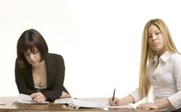 Two young women working Royalty Free Stock Image