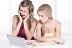 Two young women working with computer Stock Photos