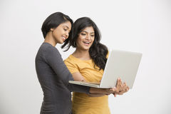 Two young women working in laptop Royalty Free Stock Image