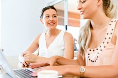 Two young women working together at laptop Royalty Free Stock Photo