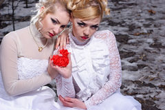 Two young womn in white dresses Royalty Free Stock Photography