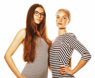 Two young workers isolated on white, same dresses in strip. Two young workers isolated on white, wearing same dresses in strip, glasses Royalty Free Stock Photography