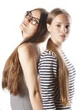 Two young workers isolated on white, same dresses Stock Photos