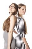Two young workers isolated on white, same dresses Royalty Free Stock Photo
