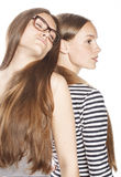 Two young workers isolated on white, same dresses Stock Photography