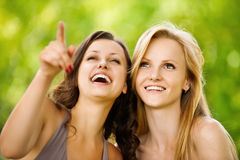 Two youngl pretty women in a park Stock Images