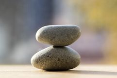 Two zen stones pile, grey meditation pebbles tower. Indoors decoration royalty free stock photography