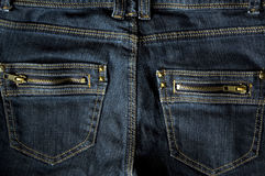 Two zip pocket blue jeans. Close up back zip pocket on blue jeans Royalty Free Stock Photography