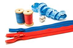 Two zipper, meter, thimble and spools of thread Stock Image