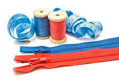 Two zipper, meter and two spools of thread Royalty Free Stock Photography