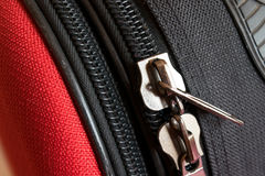 Two zipper on red and black luggage back Stock Photos