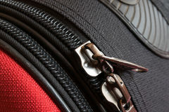 Two zipper on red and black luggage back Royalty Free Stock Images