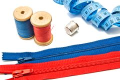 Two zipper, thimble, meter and spools of thread Stock Images