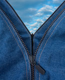 Two zippers opened a blue sky with large clouds Stock Photo