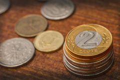 Two zloty coin. On stack with onther coins in background Royalty Free Stock Photo