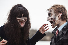 Two zombies laughing out loud Stock Photography