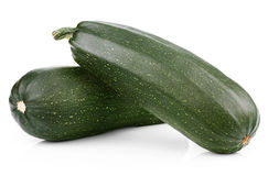 Two zucchini on white. Two fresh vegetable zucchini  on white Royalty Free Stock Photo