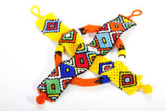Two Zulu Beaded Wristbands and Orange Armband Royalty Free Stock Photos