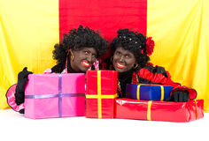 Two Zwarte Pieten lying. Zwarte Piet (Black Pete) is a character, part of a  Dutch tradition called Sinterklaas, which is celebrated at December the fifth Stock Photo