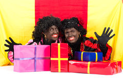 Two Zwarte Pieten lying. Zwarte Piet (Black Pete) is a character, part of a  Dutch tradition called Sinterklaas, which is celebrated at December the fifth Stock Images