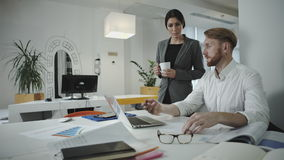 Twoemployees working in the office. Two employees working in the office. Sit  and  use digital tablet and phone stock video