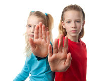 Twogirls making stop sign with hand Stock Image