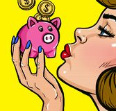 TWoman kissing a piggy bank in Pop Art style.Vintage pop art poster.Woman with money royalty free stock photography