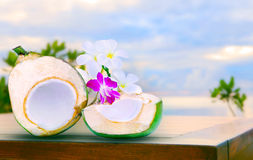 Twon half of green coconut water on top  wood table with tropica Stock Photos