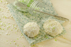 Twoo cookies with coconut flakes on cotton cloth. Near glass jar. Royalty Free Stock Photography