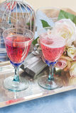 Twoo glasses of pink champagne Stock Photos