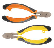 Twopliers1. Image of two pliers orange and yellow on white background Royalty Free Stock Image