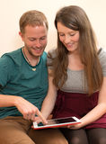 Twosome using tablet pc Royalty Free Stock Photo