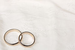 Twoweddings rings on a silk Royalty Free Stock Photo