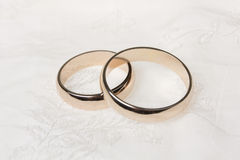 Twoweddings rings on a silk Stock Photos