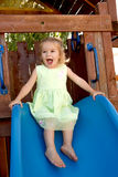 TwoYears Old Girl Fulfilled on the Slide Stock Images