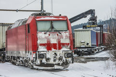 TXL 185 404-1 with freight train transit in Halden Stock Images