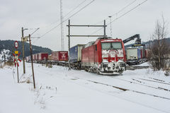 TXL 185 404-1 with freight train transit in Halden Royalty Free Stock Photography