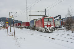 TXL 185 404-1 with freight train transit in Halden Royalty Free Stock Photo