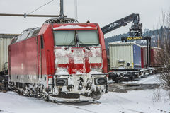TXL 185 404-1 with freight train transit in Halden Stock Image