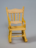 Toy chair. A wooden toy rocking chair stock photography