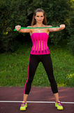 Ty woman with speed rope in park Royalty Free Stock Photography