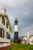 Tybee island beach lighthouse with thunder and lightning stock images