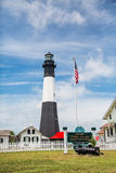 Tybee Island Lighthouse and American Flag Stock Photography