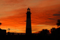 Tybee Island Lighthouse At Sunset. Old historic lighthouse and keeper house on Tybee Island Georgia at sunset stock photography