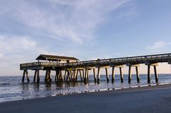 Tybee Island pier in Southern Georgia United States on the beach of the Atlantic Ocean, golden hour. With beautiful sky stock photo