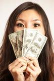Tyck om framställning några pengar Arkivbild