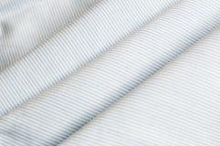Tyg för bomull för blått för vit för vinkel för övre yttersida för slut diagonalt Arkivfoto